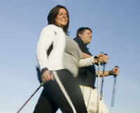 Bild: Couple Nordic walking outdoors --- Image by © Ocean/Corbis