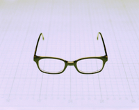 Bild: A Pair of Glasses on a Grid --- Image by © fstop/Corbis